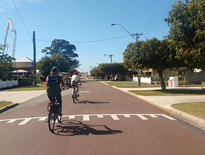 Two cyclists cycling along Bayswater Safe Active Street