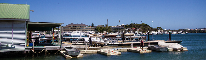 Image of jetty and boats at the Marine Education Boatshed facility