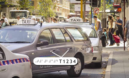 Image of taxi ID plate