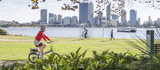 Woman cycling along the Swan River